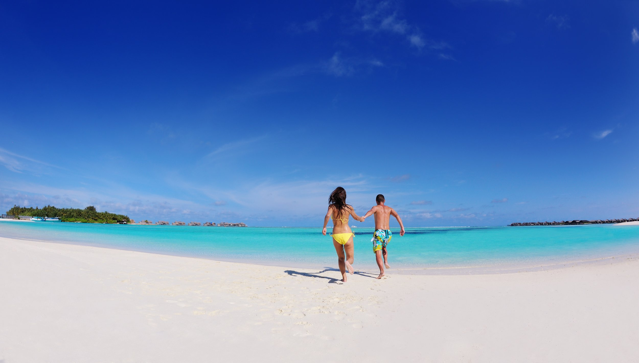 invite-to-paradise-holiday-honeymoon-sri-lanka-maldives-couple-beach-run.jpg