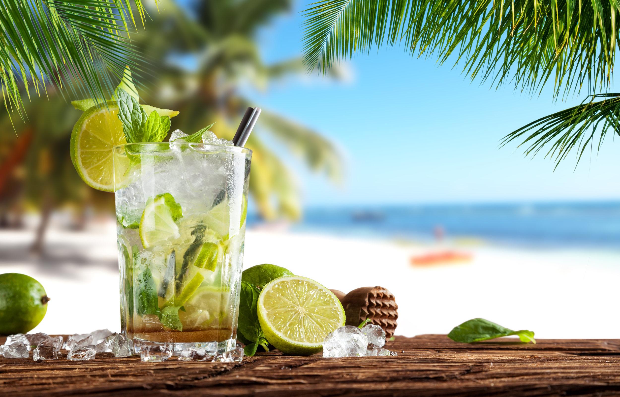 shutterstock_432153001.jpg - Summer cocktail with blur beach on background.jpg