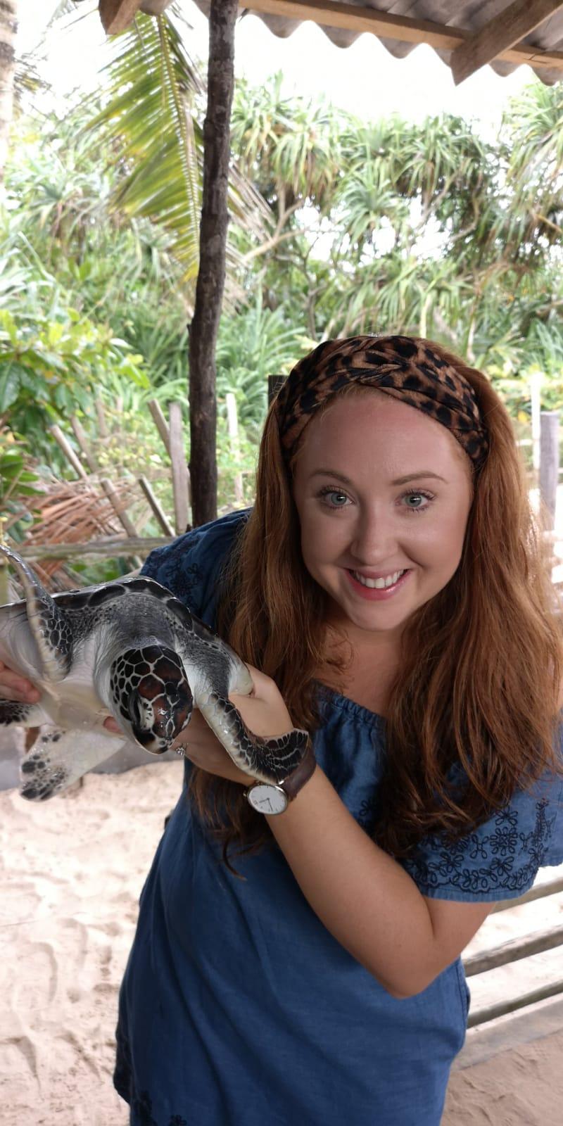 invite-to-paradise-sri-lanka-holiday-honeymoon-specialists-customer-feedback-elin-jordan-luce-sea-turtle-hatchery-hold.JPG