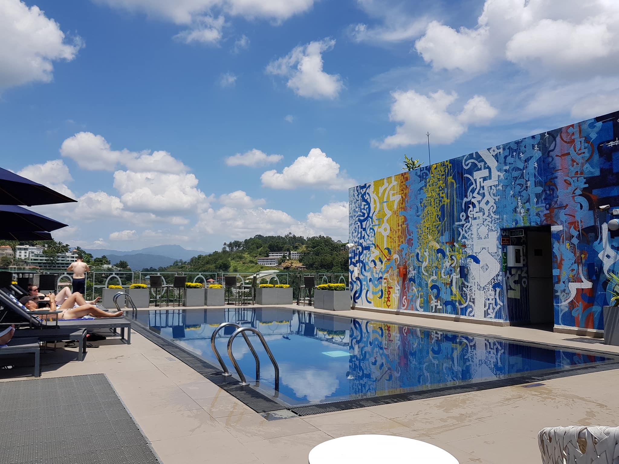 invite-to-paradise-sri-lanka-maldives-holiday-honeymoon-specialists-customer-guest-feedback-zane-lisa-butcher-kandy-ozo-hotel-pool-rooftop.jpg