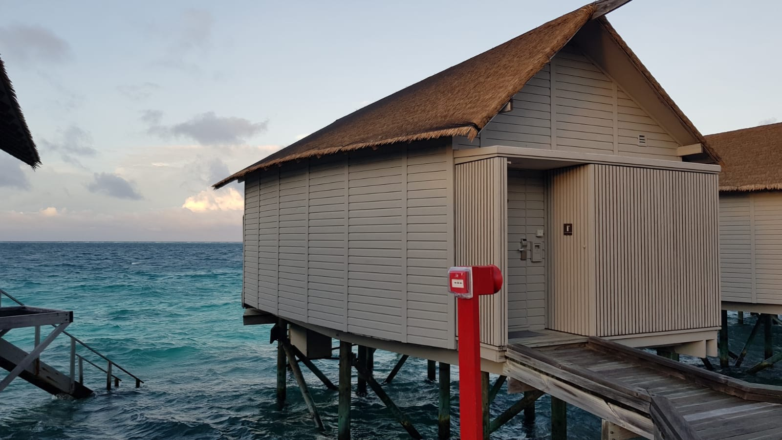 invite-to-paradise-sri-lanka-maldives-holiday-honeymoon-specialists-customer-guest-feedback-zane-lisa-butcher-centara-ras-fushi-deluxe-spa-water-villa-outside-jetty.png