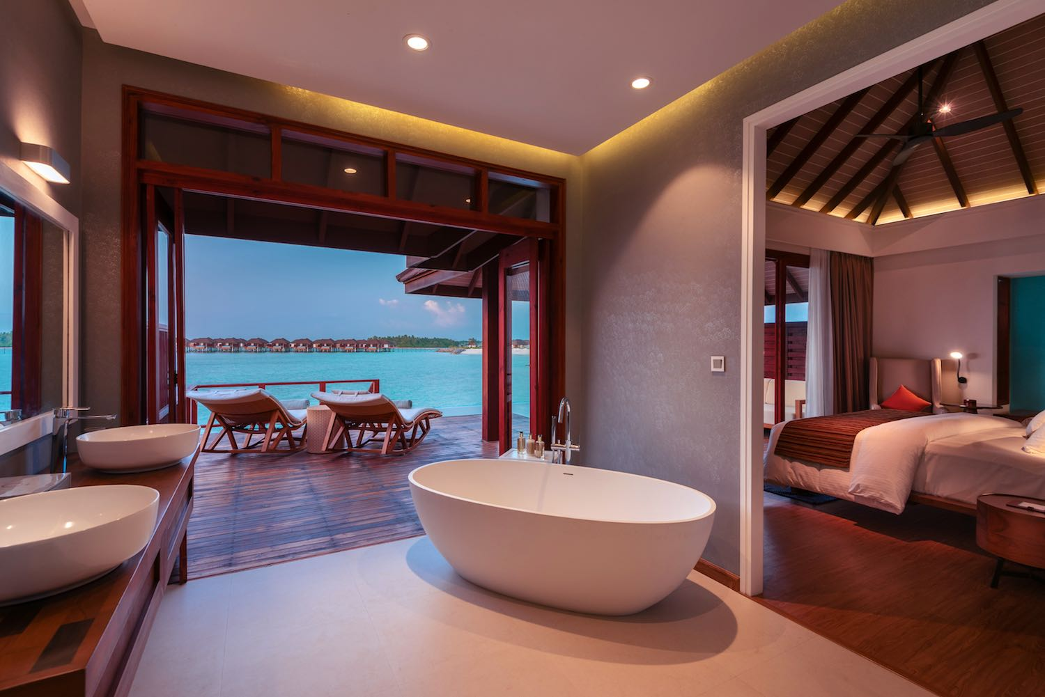 maldives-varu-by-atmosphere-water-villa-with-pool-villa-cross-section-at-dusk-holiday-honeymoon-vacation-invite-to-paradise.jpg