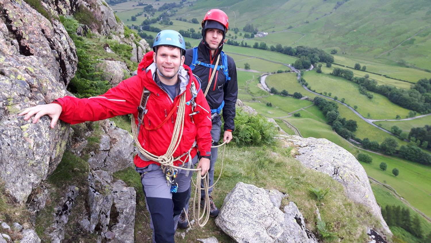Two people with coils of rope scrambling in the Lake District – Chris Ensoll Mountain Guide