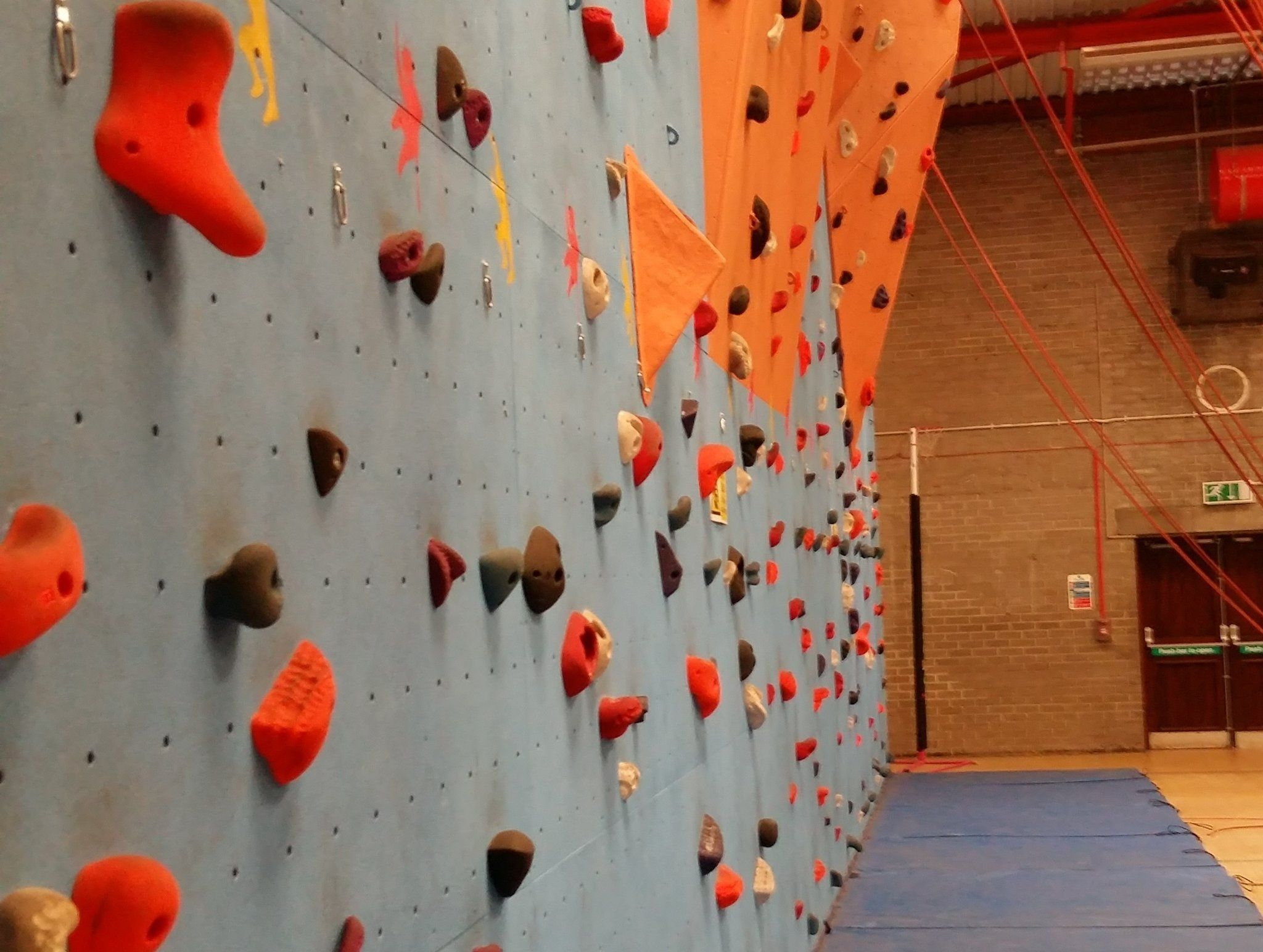 An indoor climbing wall - Chris Ensoll Mountain Guide