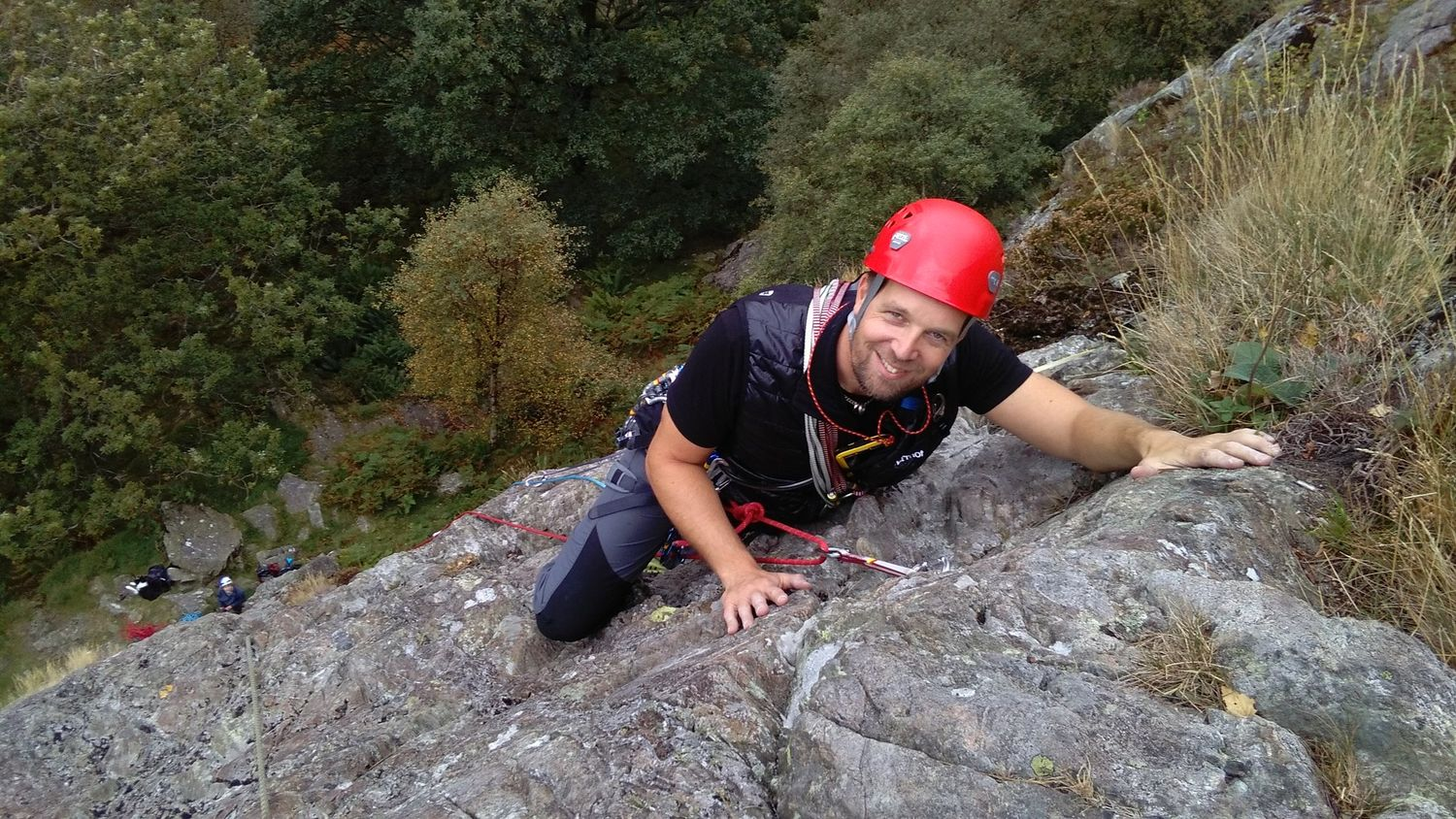 A rock climber learning how to lead a route in the Lake District - Chris Ensoll Mountain Guide