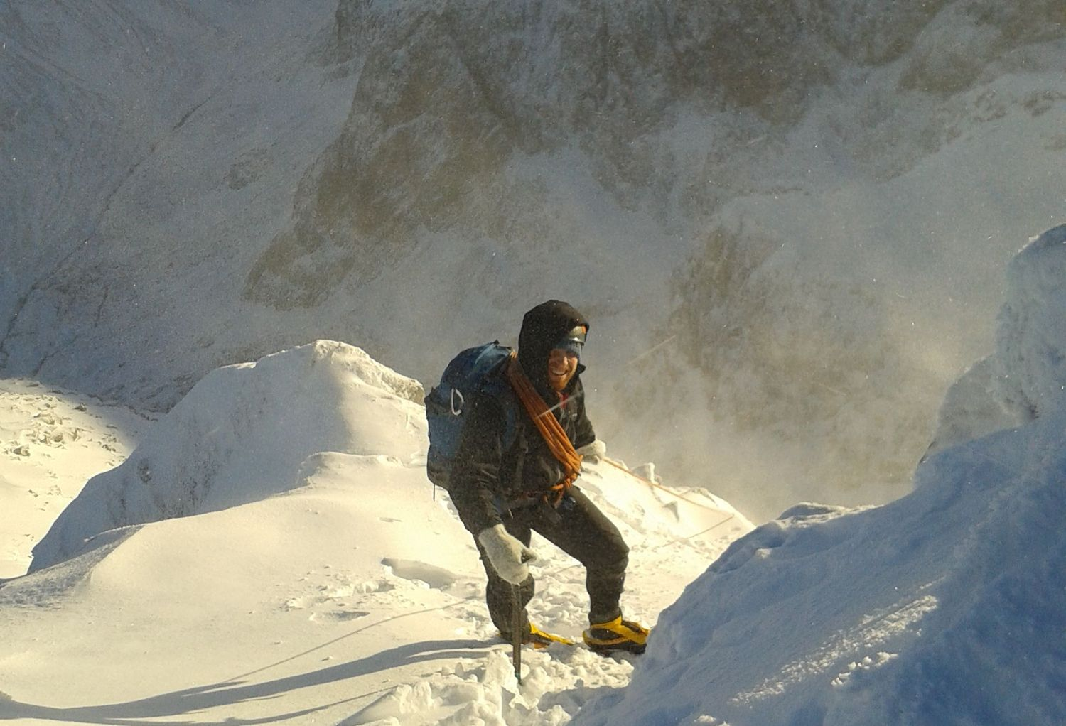 A mountaineer with coils of rope on a snowy mountain - Chris Ensoll Mountain Guide