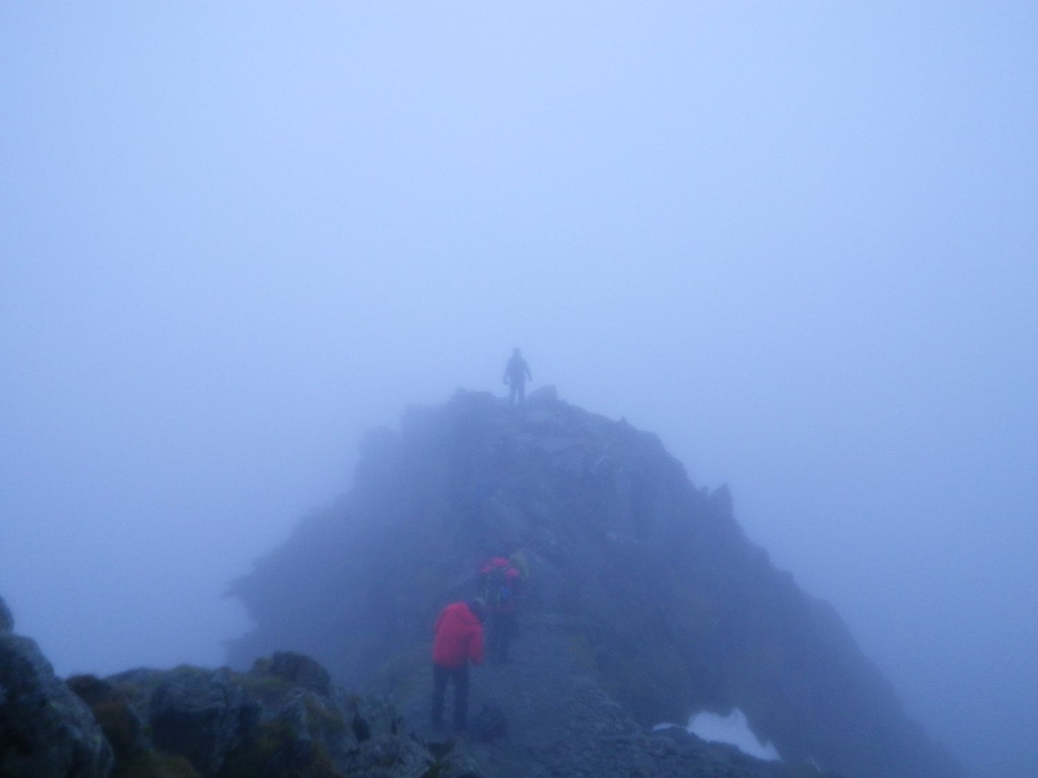 Mountain leader training candidates navigating in limited visibility