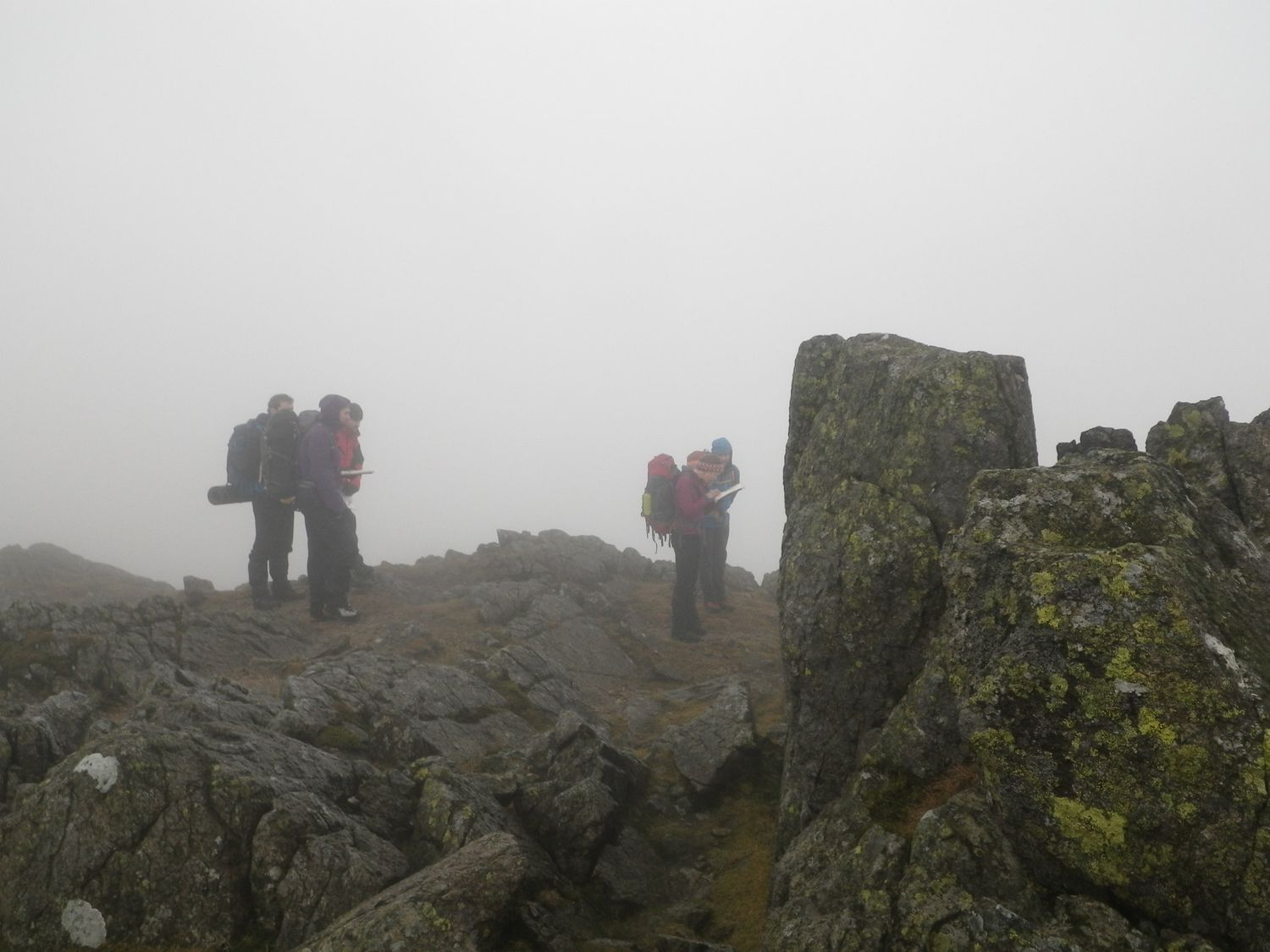 Mountain leader training candidates walking in limited visibility