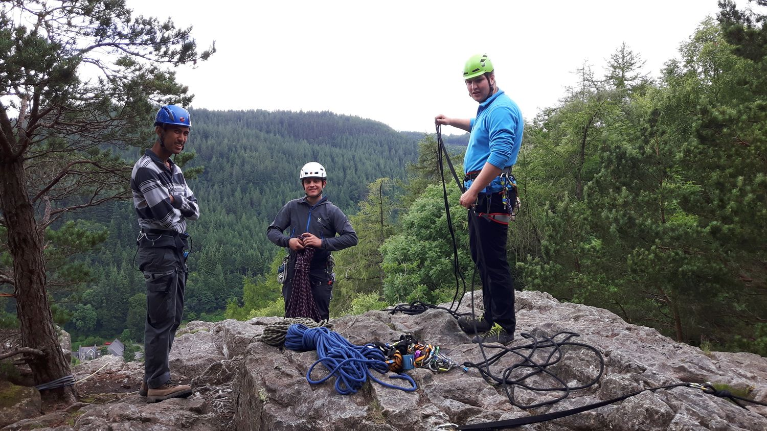 belaying at the top of a crag - chris ensoll mountain guide