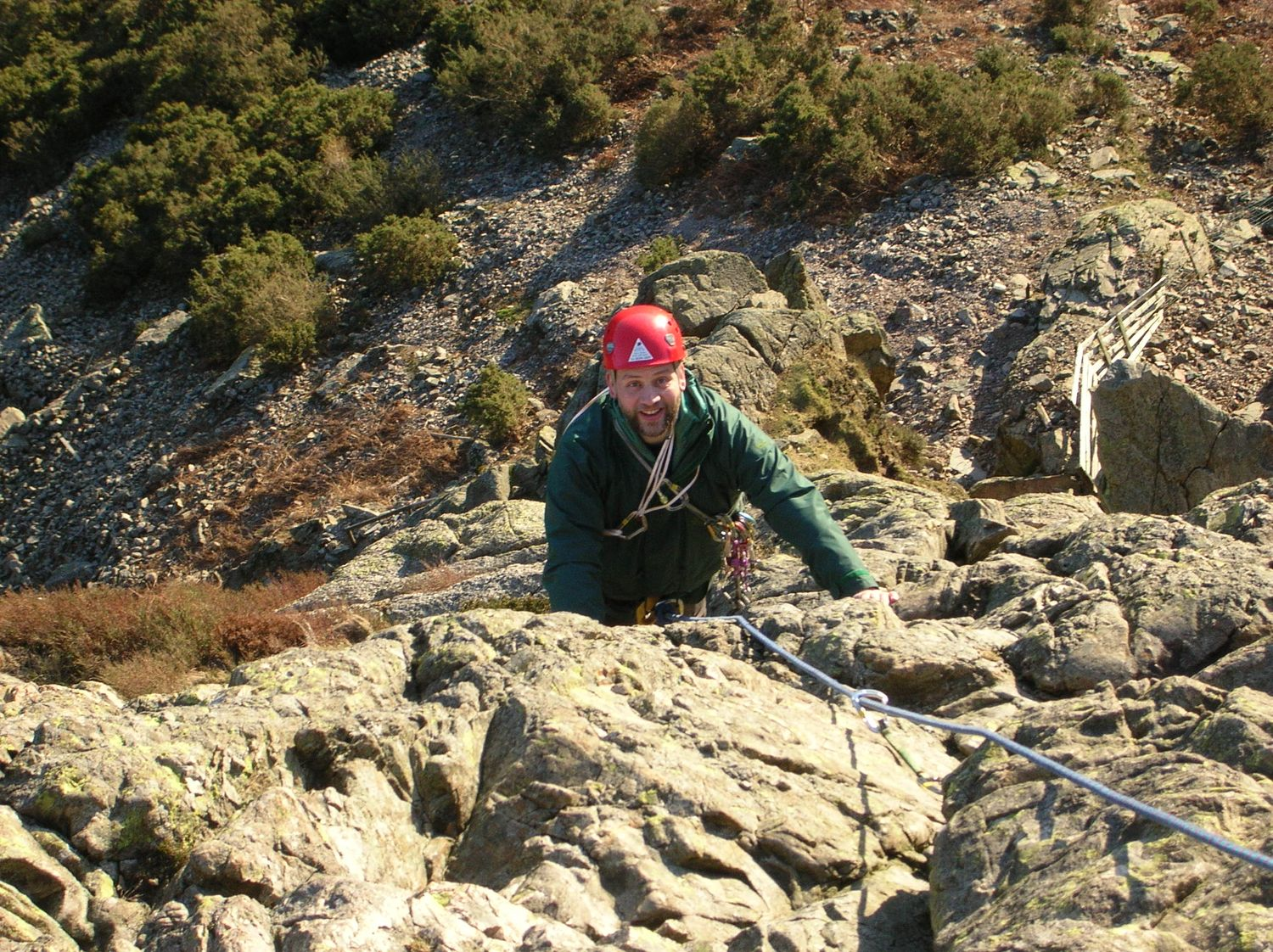 A client on a multi pitch rock route in the Lake District - Chris Ensoll Mountain Guide