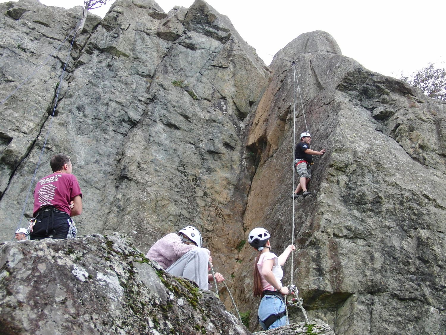Clients climbing a belaying on a single pitch crag in the Lake District - Chris Ensoll Mountain Guide
