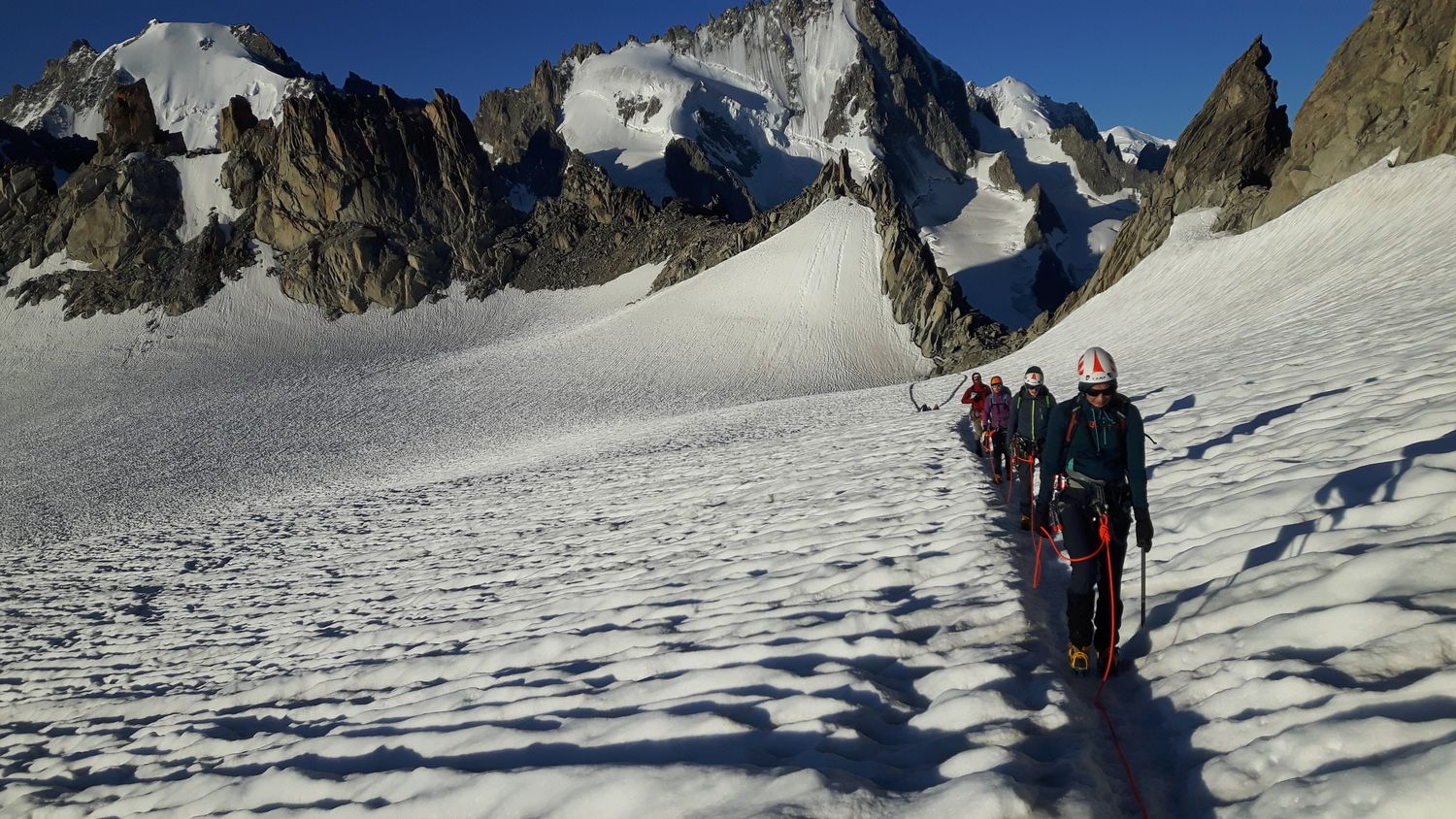 Crossing the Col Superieur du Tour on to the Trient Plateau with the Aiguille du Chardonnet behind