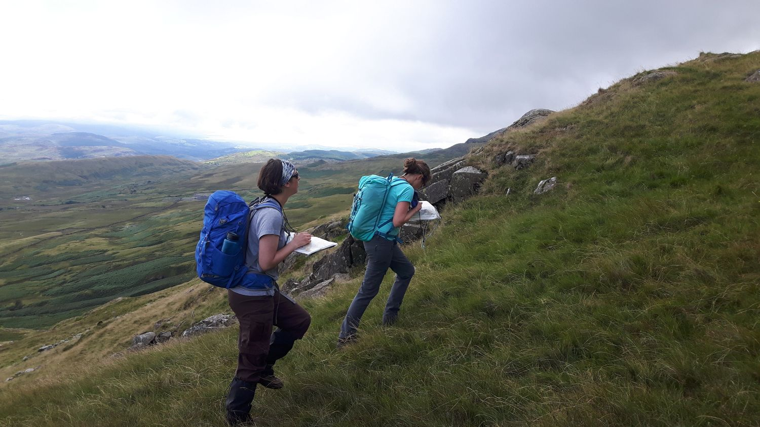 Mountain leader training candidates navigating in the mountains