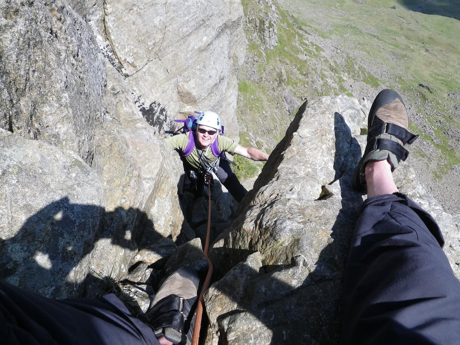 A client on a multi pitch rock climb in the Lake District - Chris Ensoll Mountain Guide