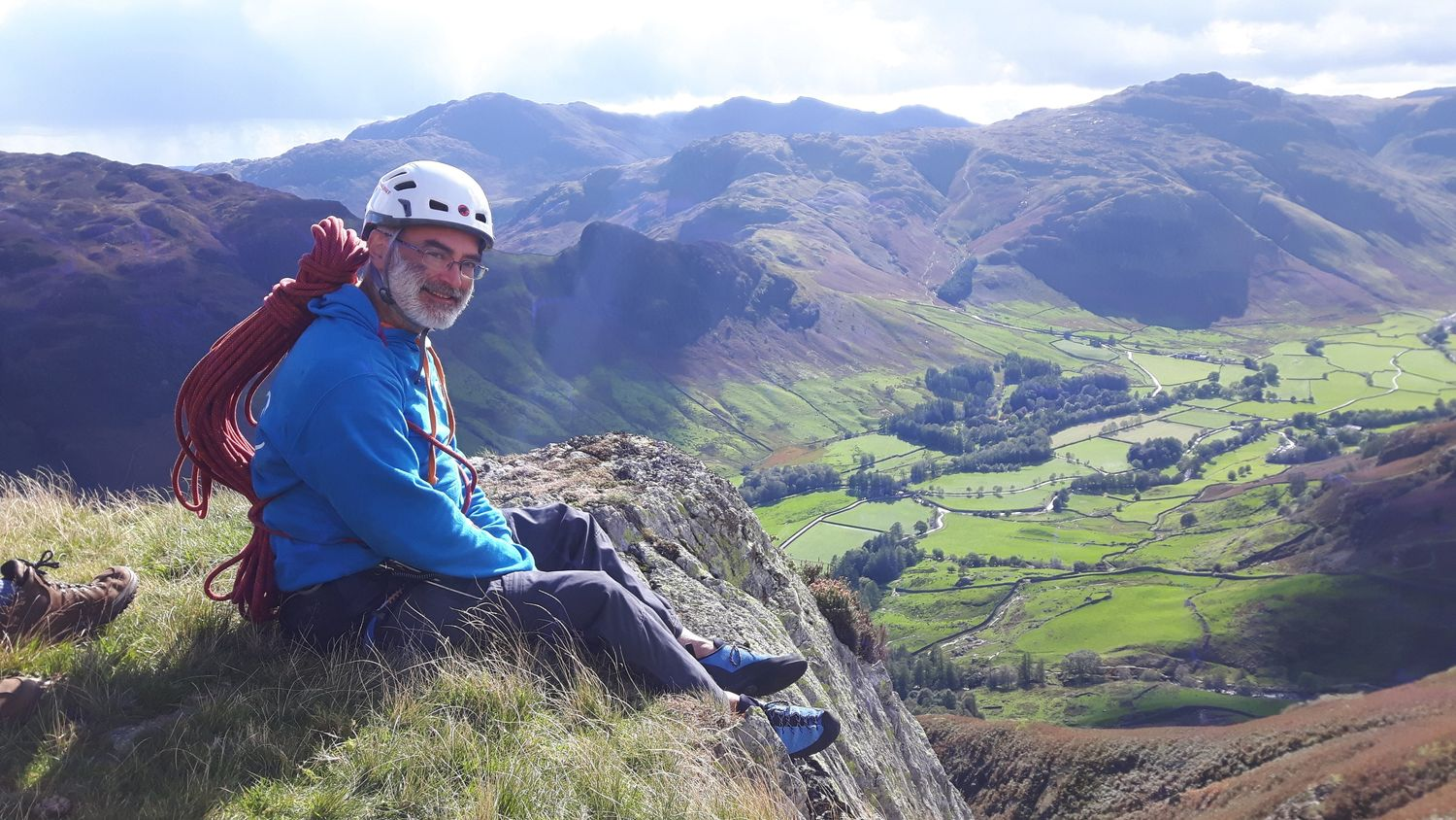 A client savouring success at the top of a multi pitch rock climb in the Lake District - Chris Ensoll Mountain Guide