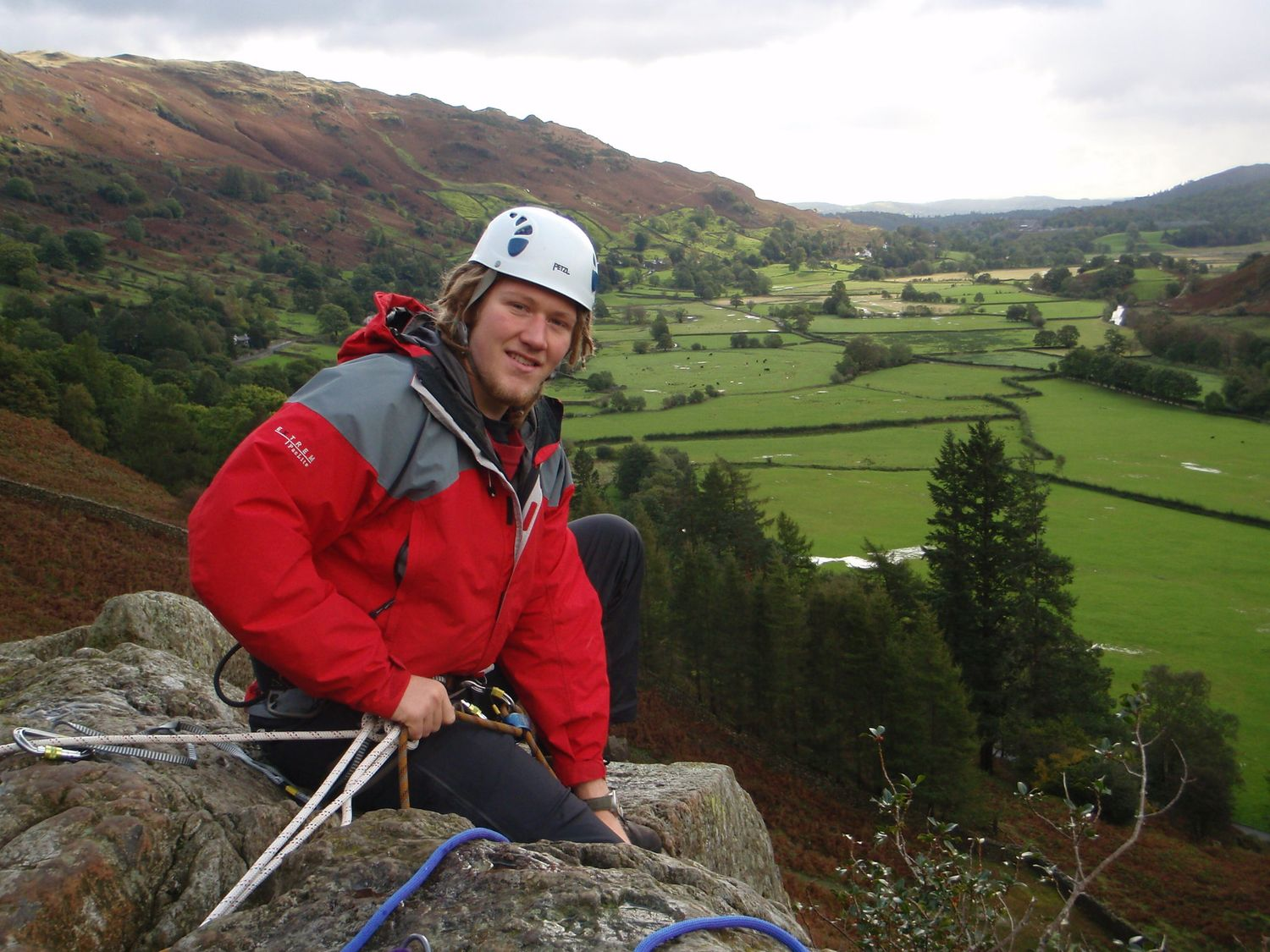Belaying at the top of a route on a Rock Climbing Instructor course - Chris Ensoll Mountain Guide