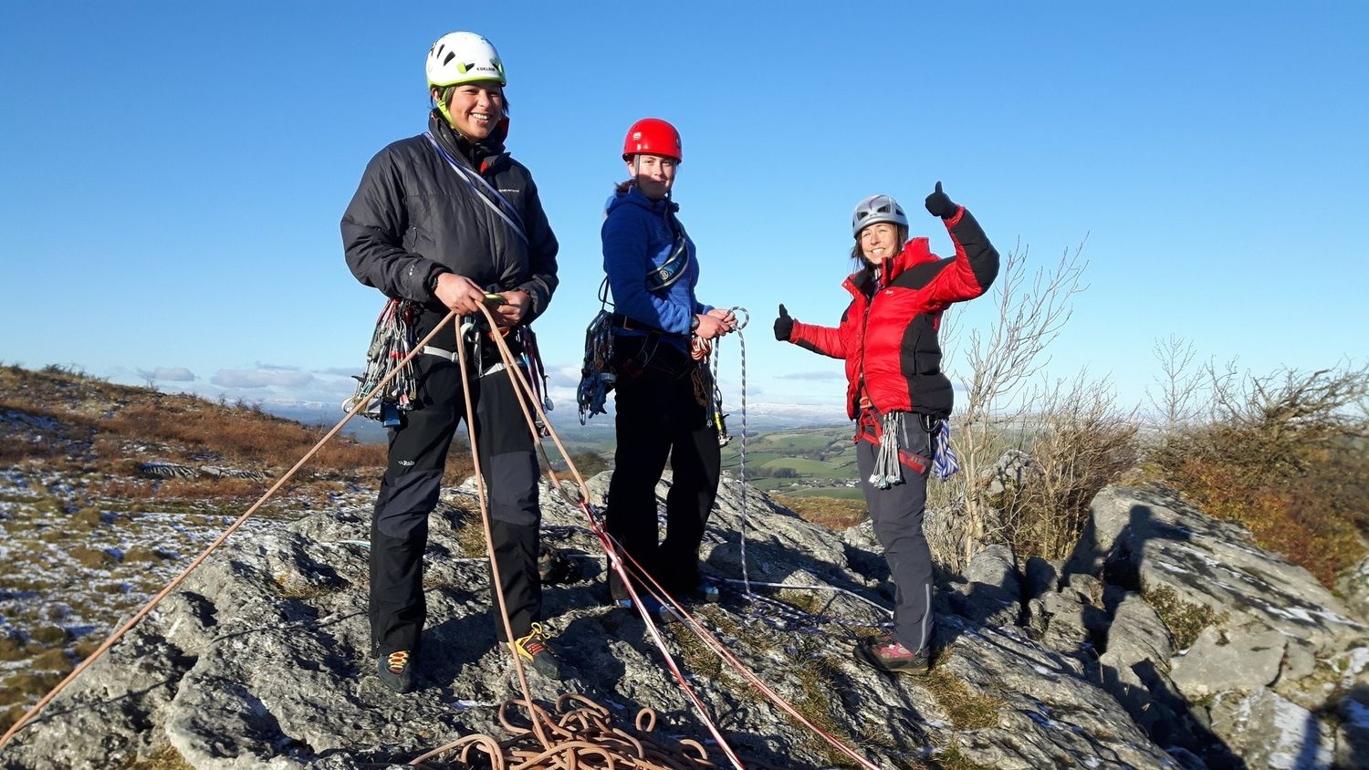 Setting up a belay at the top of a route on a Rock Climbing Instructor course - Chris Ensoll Mountain Guide