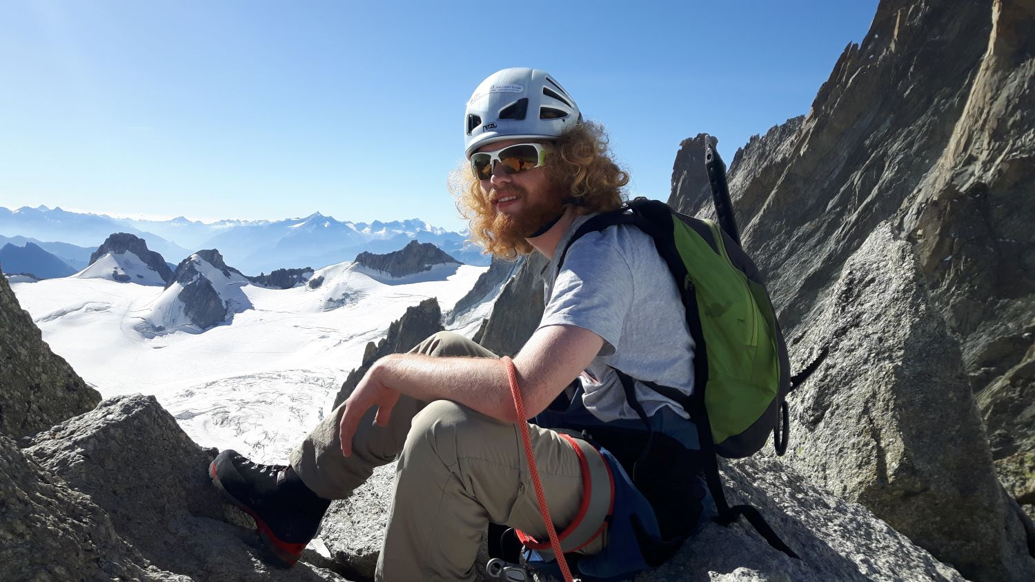 Day three: Sam on the summit of Pointe Lachenal, looking towards Italy