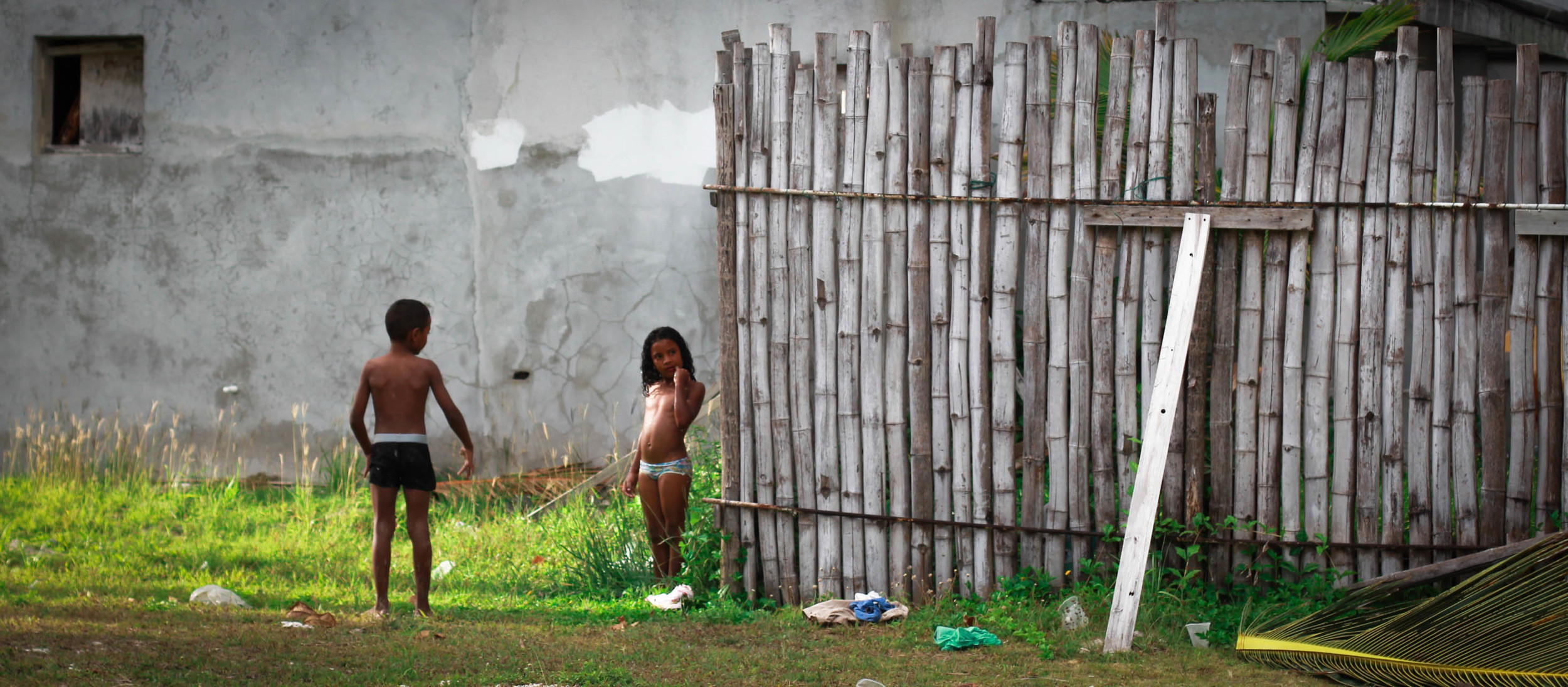 caye caulker kids shower by fence