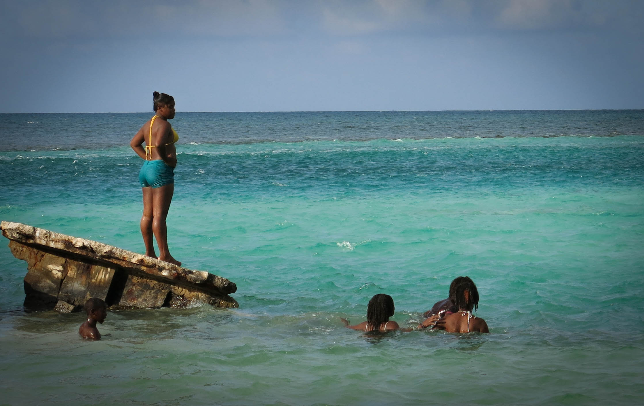 caye caulker family plays in ocean