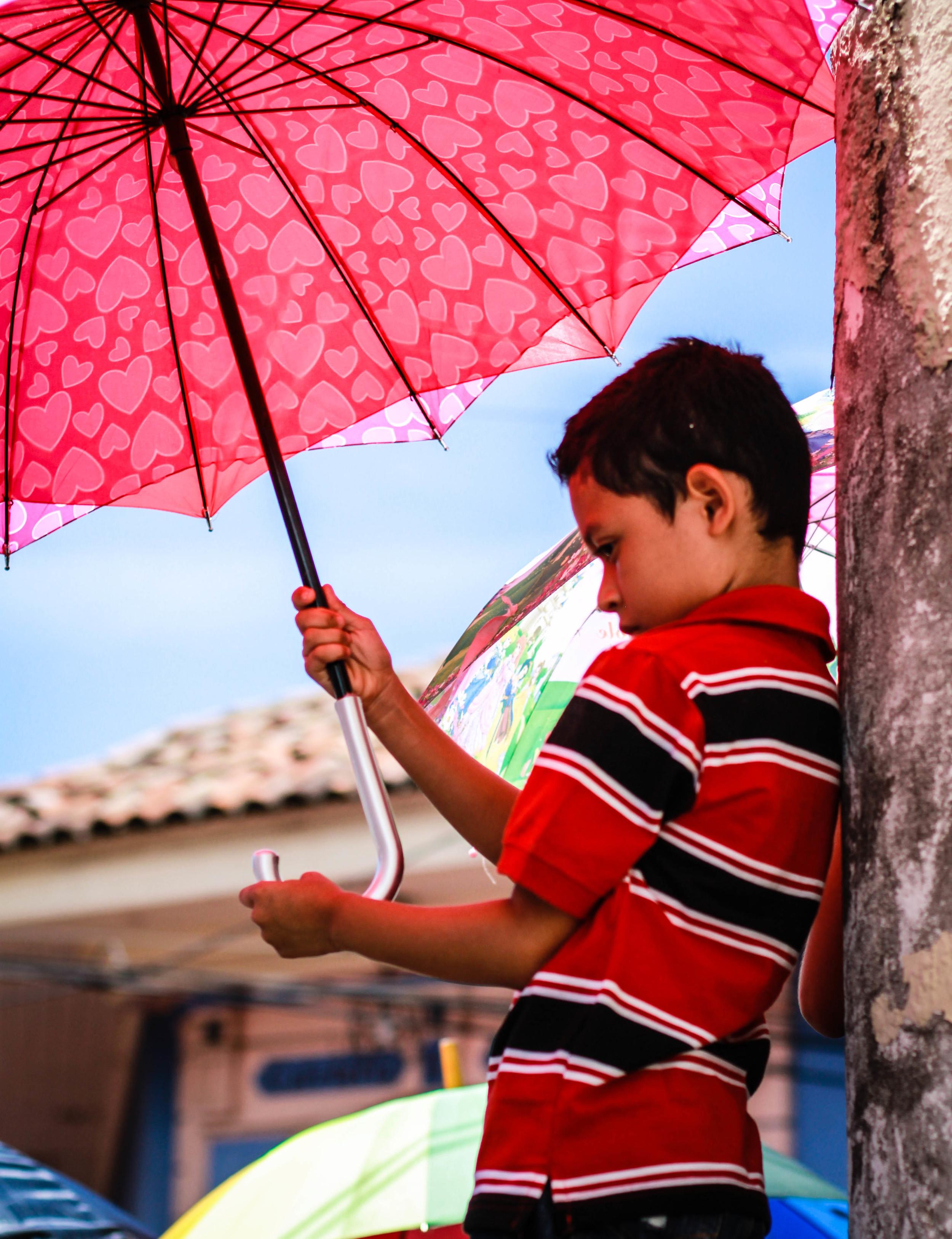 boy-umbrella-leon-nicaragua