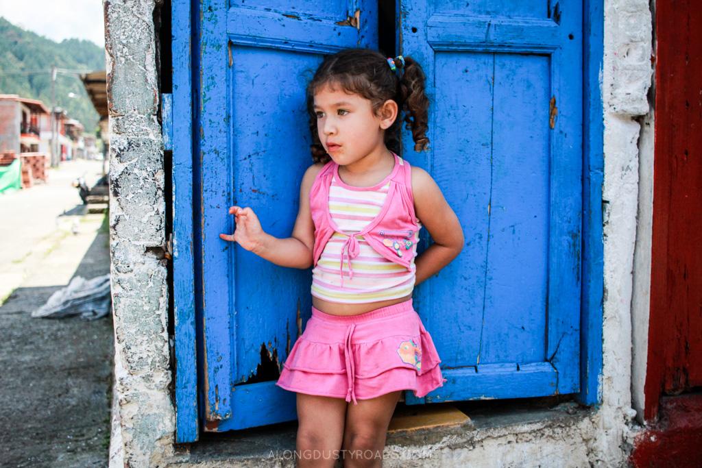 girl in jardin colombia - along dusty roads