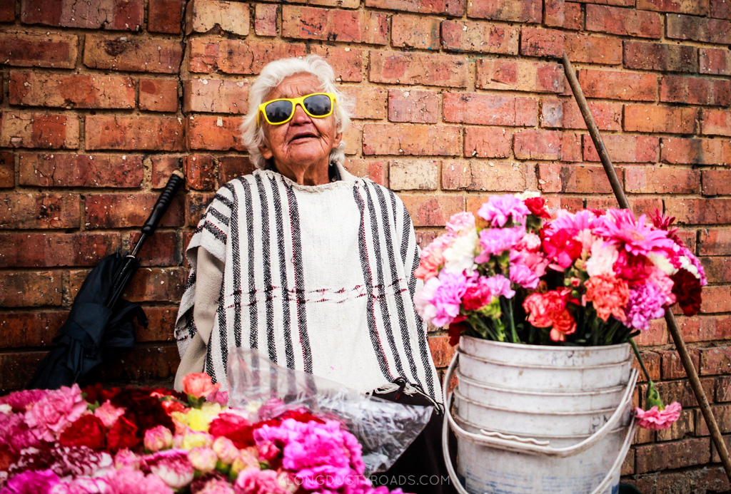 the flower lady - bogota, colombia (alongdustyroads.com)