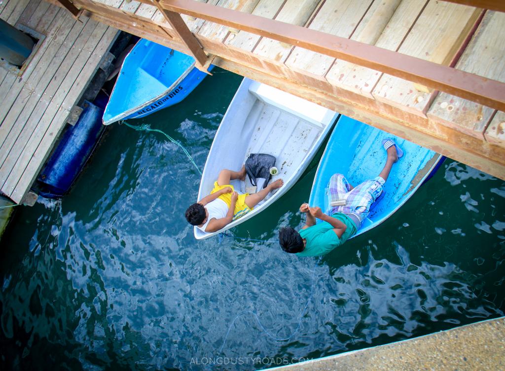 Puerto Lopez, kids in boats.