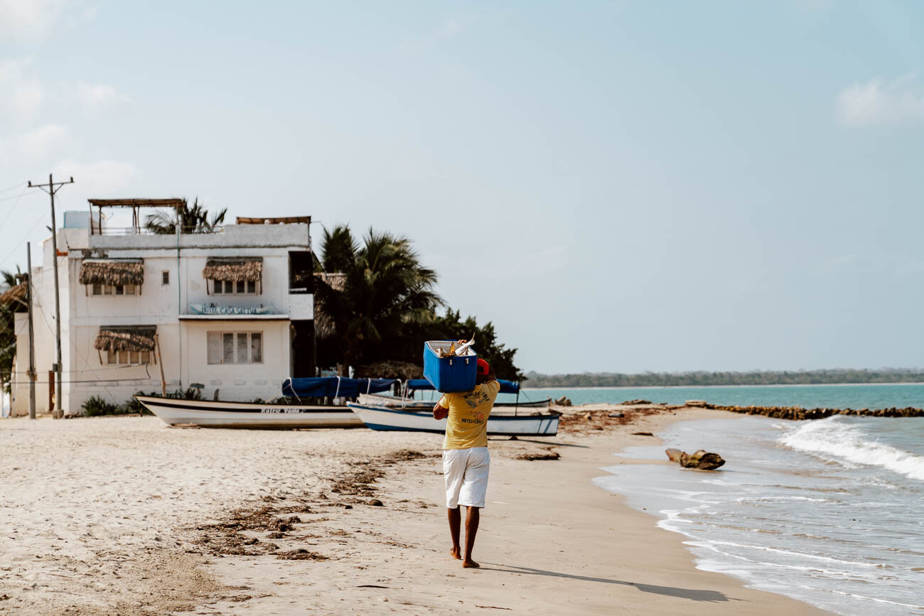 A Guide to Rincon del Mar | Fisherman walking along the beach