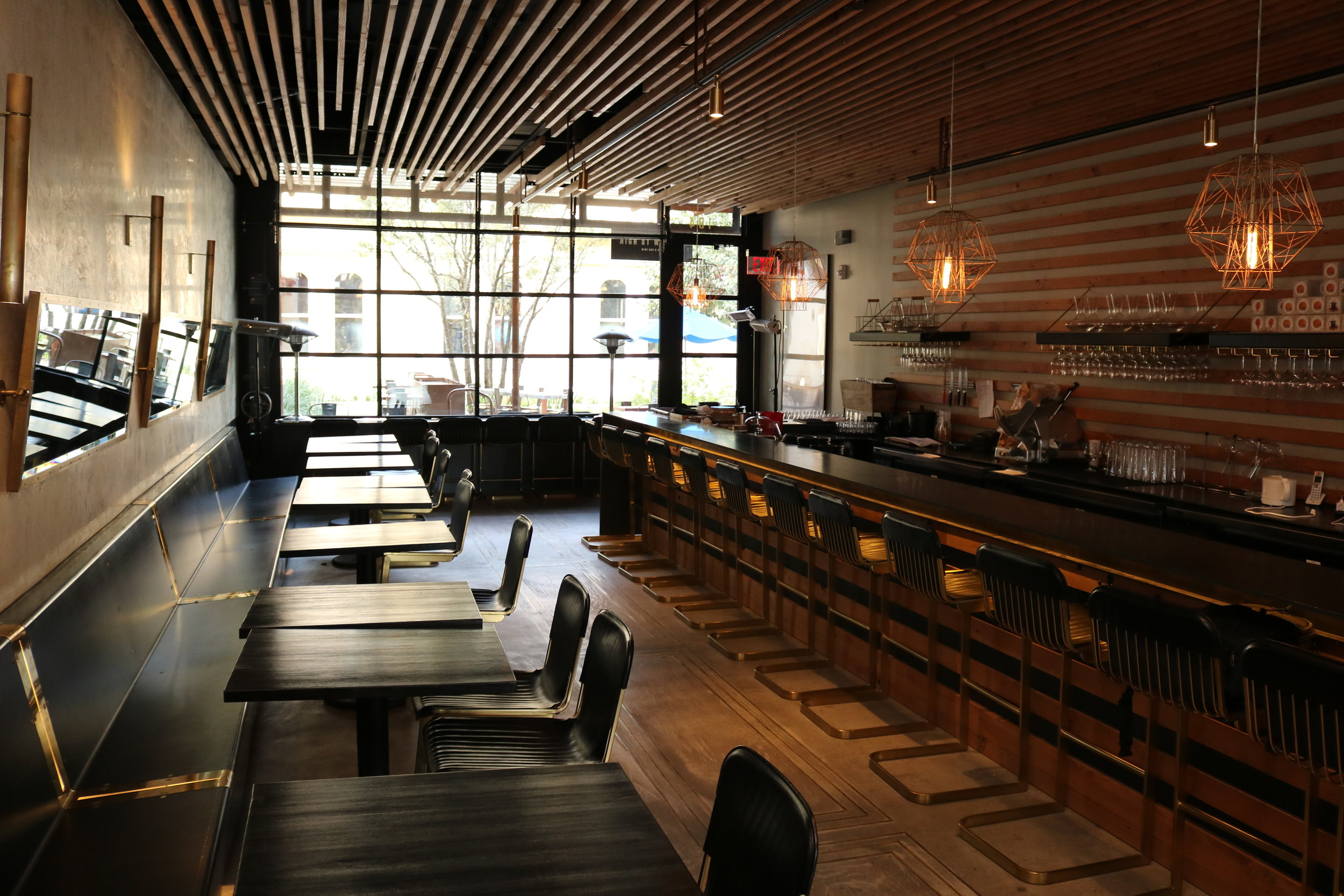 The interior of High Street Wine Co. explores an upscale design that caters to an elevated audience as well as the new wine drinker.