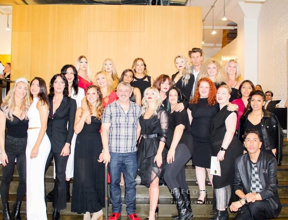 School owner Nick Arrojo Celebrates Graduation Day with Graduates, models and faculty.