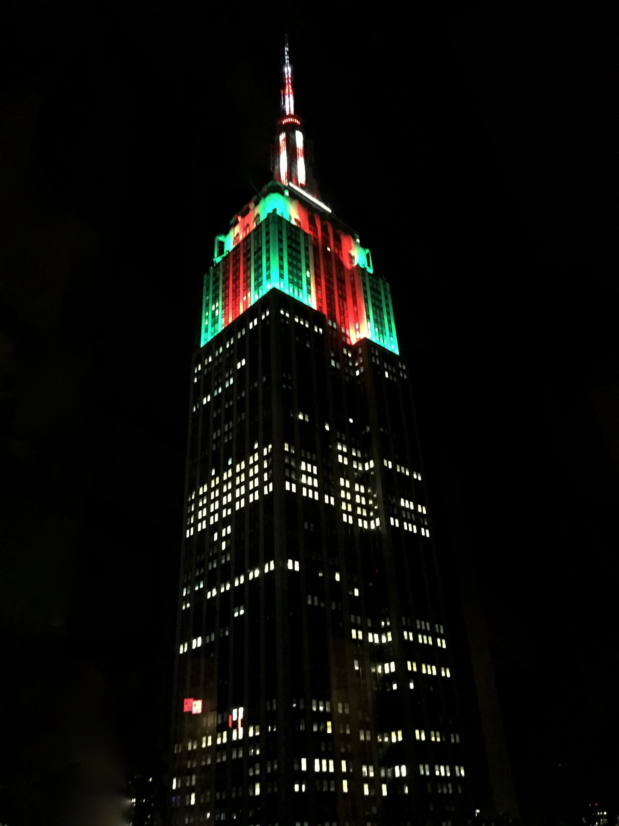 Empire State Building lit up in red and green.