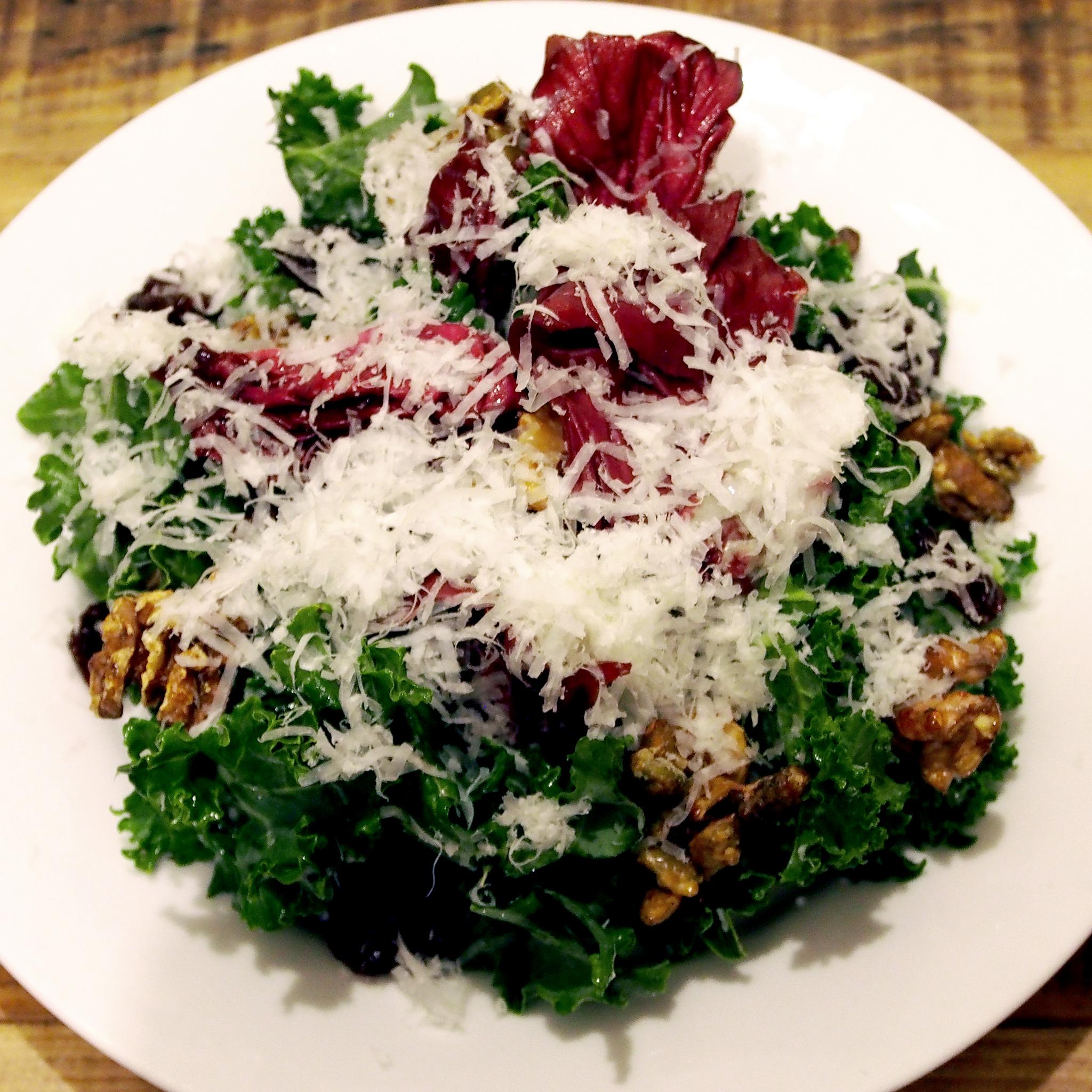 Cherry, kale & walnut salad with radicchio, Pecorino cheese and pumpkin seeds. Yum!