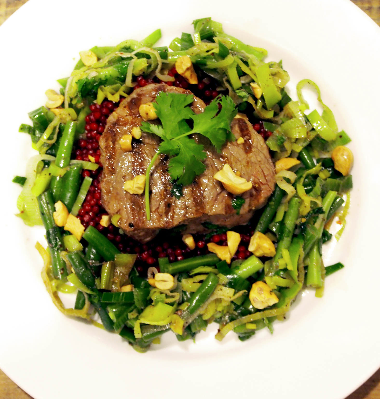Meisterdish's  Lavender steak on pearl couscous with green beans, leeks, and cashew nut. All photos ©  Suzanne Spiegoski