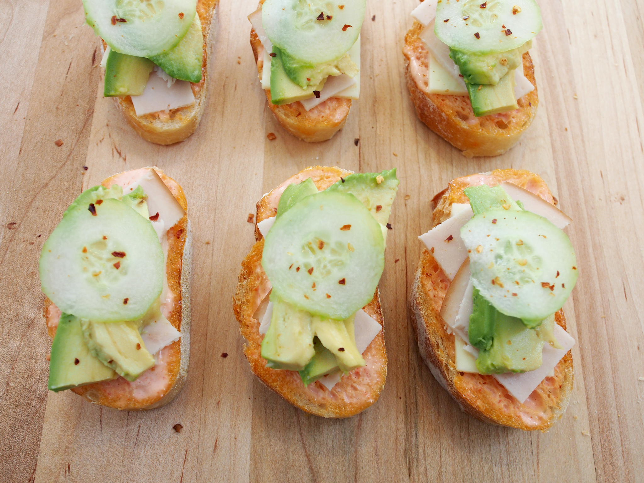 Mini Open Faced Turkey Avocado Sandwiches with Havarti cheese, cucumber and roasted red pepper mayo. All photos © Suzanne Spiegoski