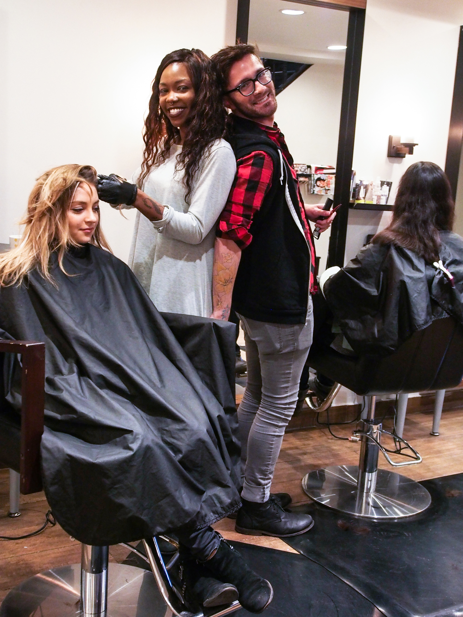 My personal hair stylist,  Lataye Studwood  (left) hard at work on another client with hair-cutting sweetie,  Richie Andrew  (right). Nothing but good vibes in here!