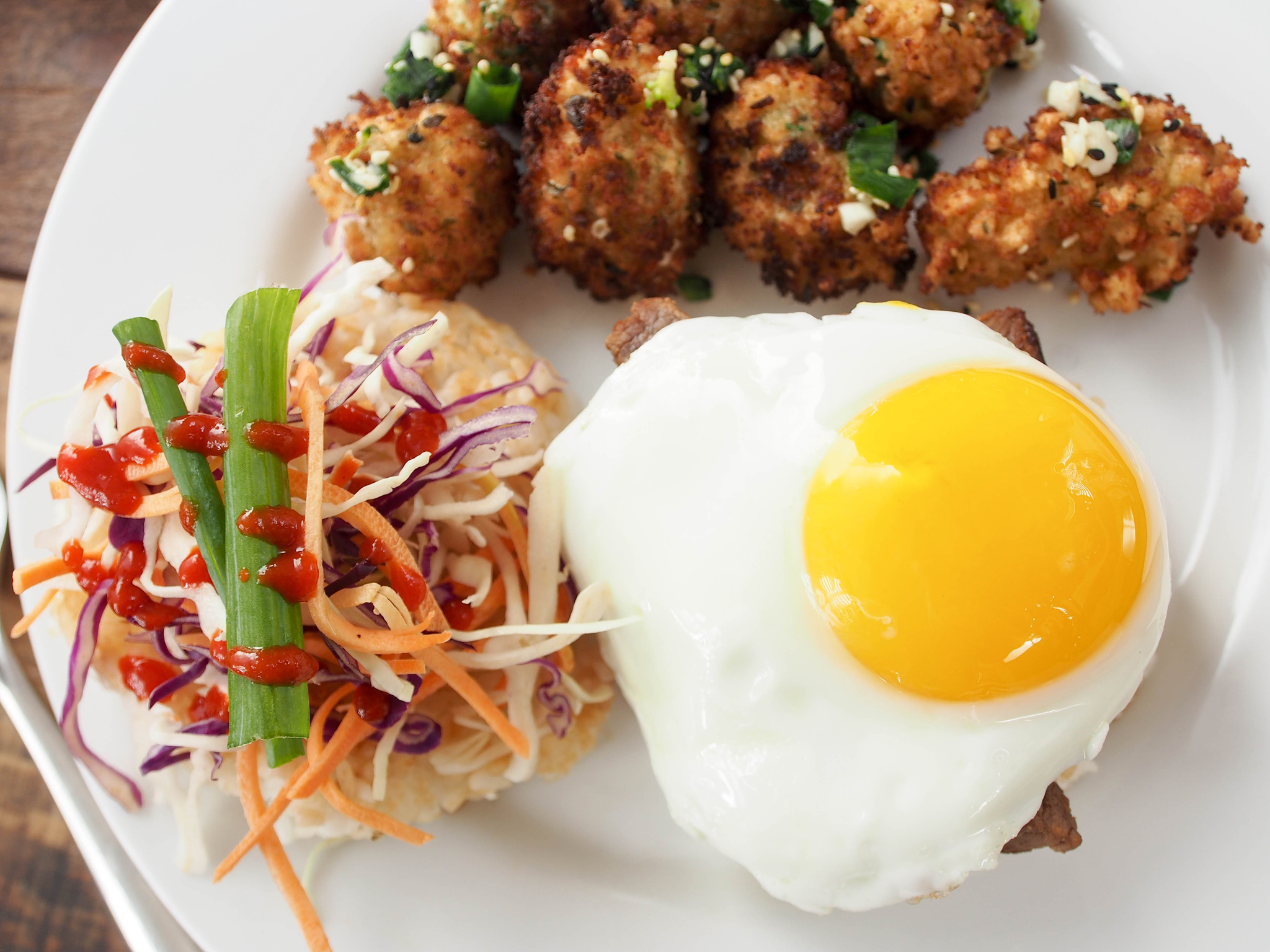 Close-up of the fried sesame broccoli and a top view of the burger. Look at that perfect sunny side up egg!