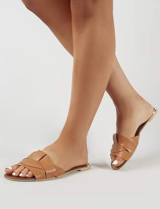 Tan slip-on sandals