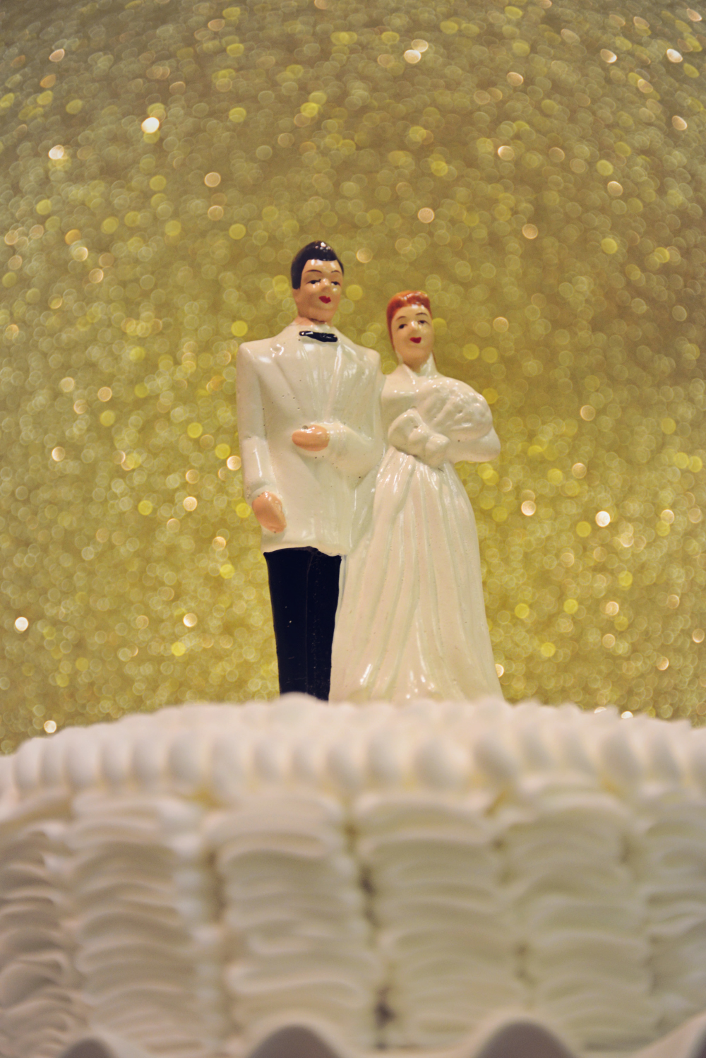 This is a close up of the original cake topper from Byron's parents wedding that we used on a small cake at the party.