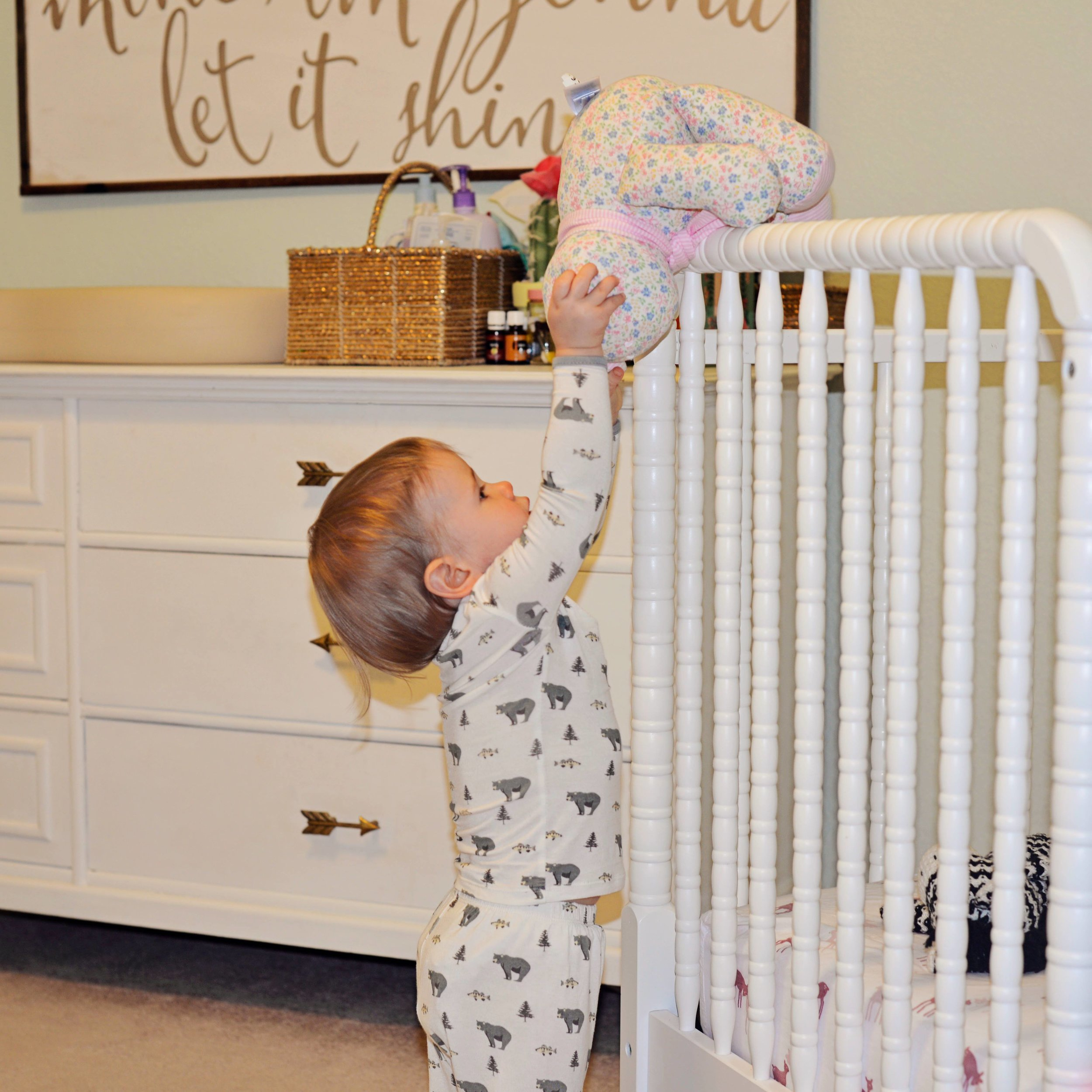 My girls new favorite game - throwing all over her babies and animals into her crib. She is wearing the softest pajamas from Kyte Baby and they come in the cutest prints