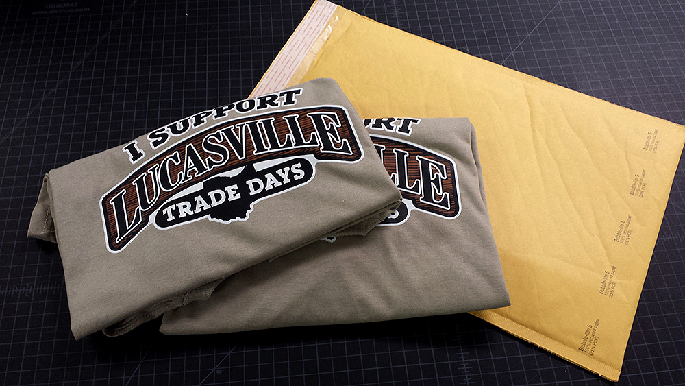 Two khaki shirts prepare themselves for the rough and tumble journey as they are shipped to their new home. We have many other shirts like these, in various sizes, looking for a new home. Show your support for the Lucasville Trade Days event by giving another homeless shirt a new life by welcoming it into your home. :-)