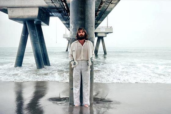 I thought about putting an actual photo of a young Charles Manson with his guitar here, but I decided that was creepy and unsettling. So here's a lovely image of Dennis Wilson on the beach. Much better!