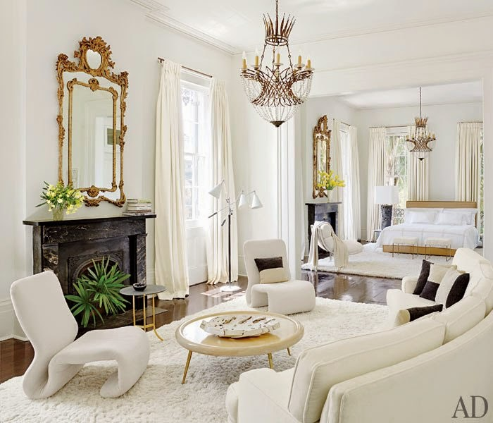 white+bedroom+wiht+black+marble+fireplace+and+gilded+ornate+mirror.jpg