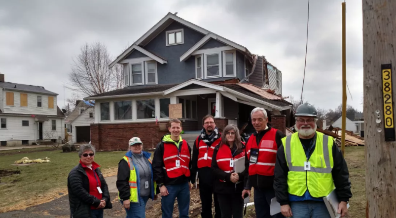 AIA DAC CHAIR ROSE GRANT, AIA (SECOND FROM LEFT) PERFORMS BUILDING SAFETY ASSESSMENTS WITH THE AIA ILLINOIS DISASTER RESPONSE TEAM AFTER AN EF-3 TORNADO HIT OTTAWA, ILLINOIS, IN FEBRUARY.