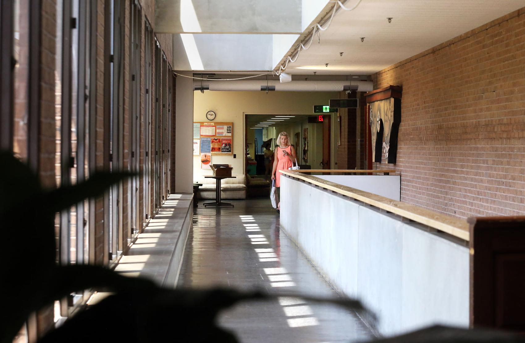 A woman makes her way down the second floor hallway of the College of Charleston's Albert Simons Center for the Arts on Monday, August 12, 2019. Brad Nettles/Staff - Brad Nettles bnettles@postandcourier.com