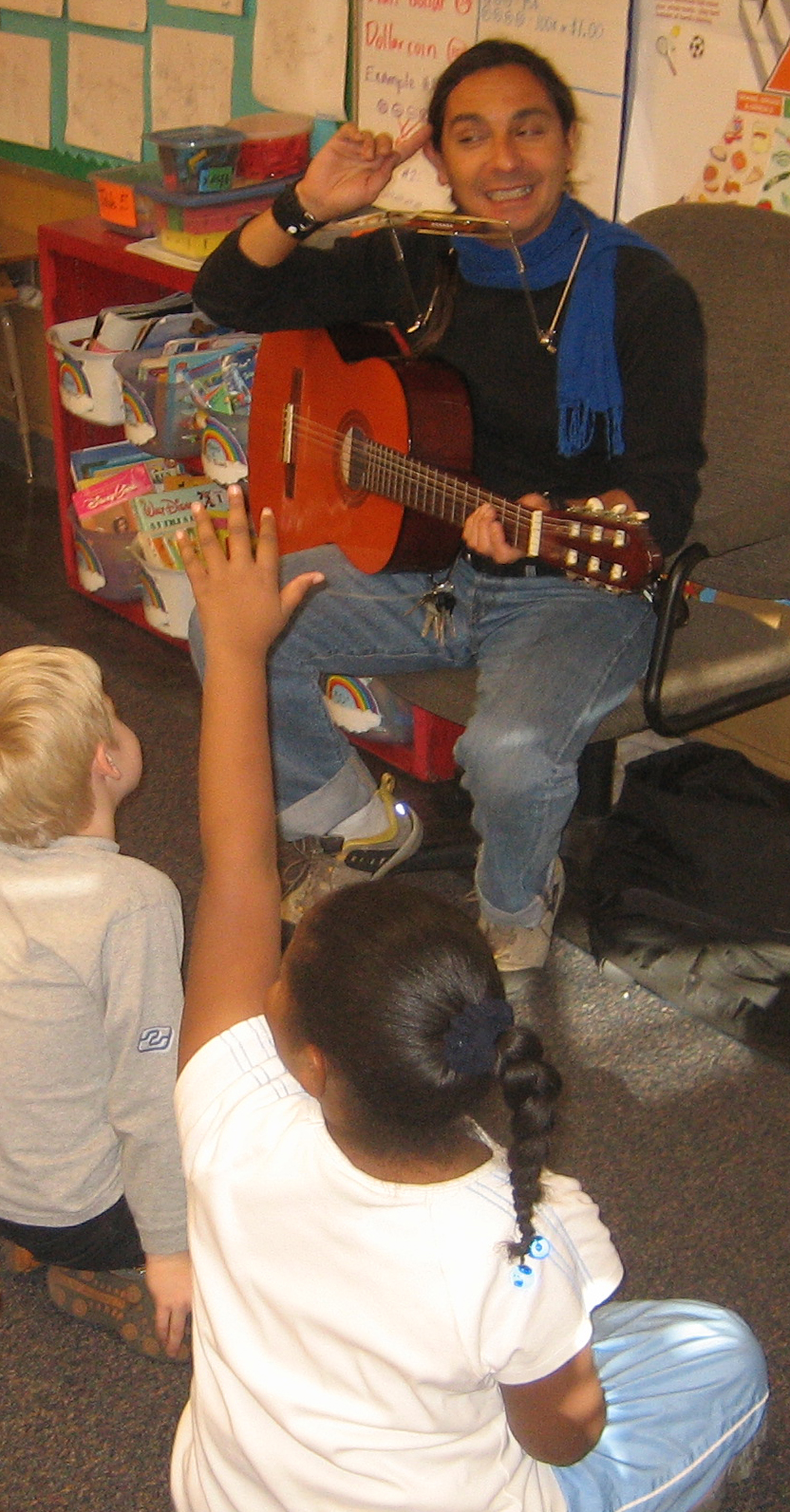 Felix with harmonica and guitar