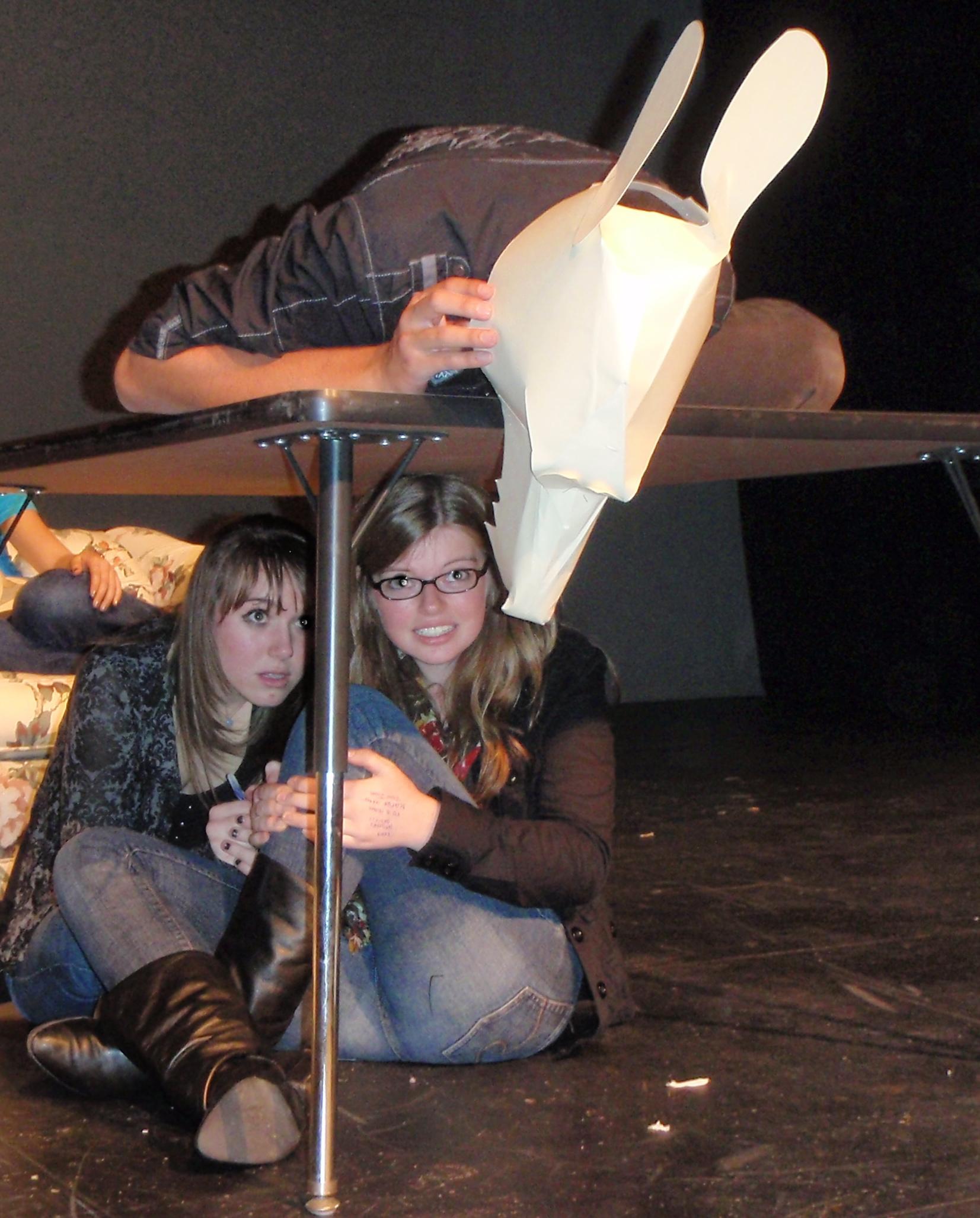 girls operating rat puppet