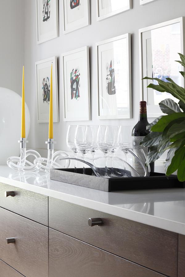 Dorothy Thorpe candlesticks, Murano lamp, Joan Miró artwork, and wine glasses on countertop | Knightsbridge London | Savage Interior Design