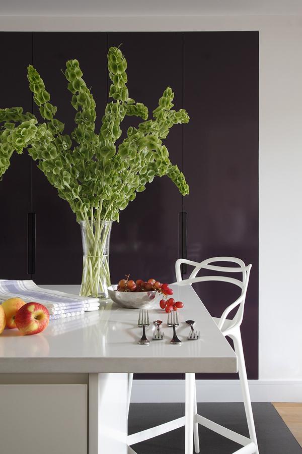 Modern white kitchen island with Knoll bar stool and aubergine cabinetry | Knightsbridge London | Savage Interior Design