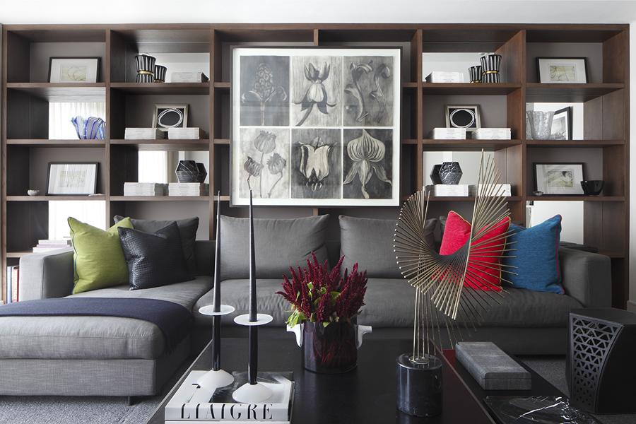 Living area with bookcase and Liaigre coffee table; C Jere sculpture; Bottega Veneta pillows | Knightsbridge London | Savage Interior Design